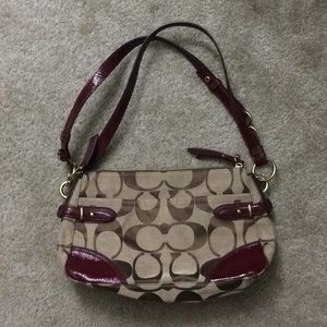 Coach shoulder bag with red leather